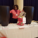 Pat Jackson with Silent Auction Items